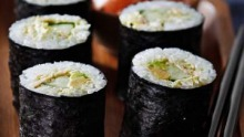 Tuna, avocado and cucumber sushi hand rolls.
