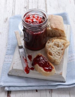 The fat in butter helps reduce the foam on top of strawberry jam.