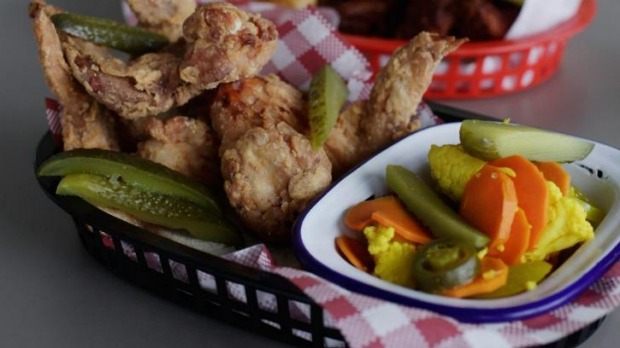 Fried chicken wings and pickles.