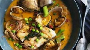 Blue-eye in a spicy broth with clams, asparagus and peas.