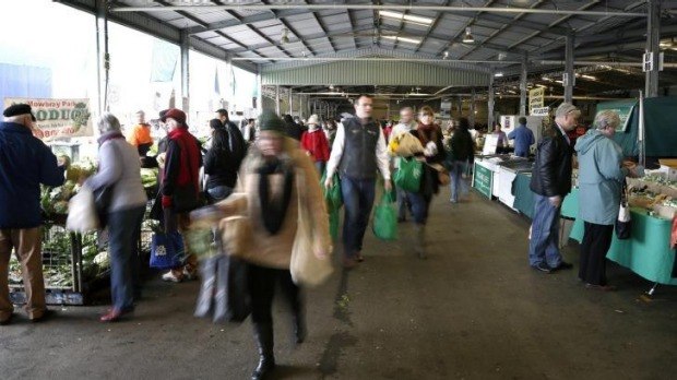 Shoppers load up on their weekly visit to the Capital Region Farmers Market.