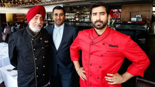 Indian summer: Father Manjit (left), with brothers Deep and Varun Gujral, at Manjit's @ The Wharf.