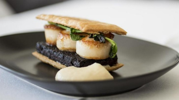 The seared scallops with boudin noir pastry.