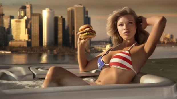 Sports Illustrated model Samantha Hoopes, in a hot tub, advertises the Most American Thickburger.