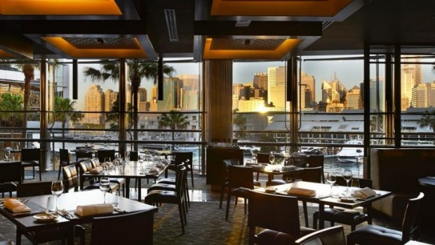 The glitzy interiors at Black by Ezard are framed by a harbour view.