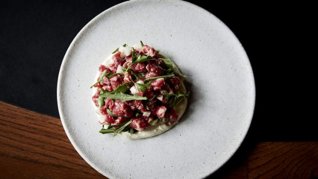 Steak tartare with radish, coastal rocket and and creme fraiche.