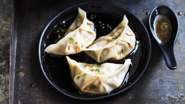 Pork and chive dumplings with red vinegar sauce. Photo: William Meppem