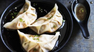 Pork and chive dumplings with red vinegar sauce.