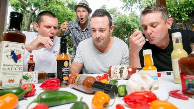 Lookin' for some hot stuff: Adam Whitby and mates Jody Coggan, Sean Masters and Matt Wilson do a hot sauce taste test.