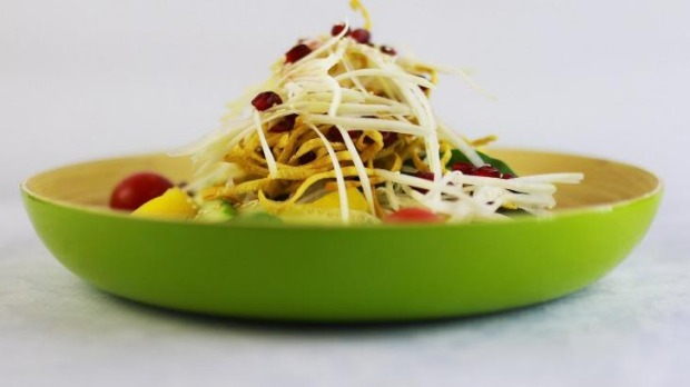 The Energy Bliss salad is powered by papaya, pomegranate and creamy coconut dressing.