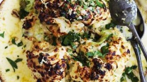 Whole cauliflower gratin with pickled celery and walnuts