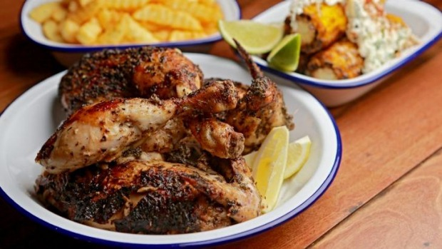 Rotisserie chicken with crinkle-cut chips and a side dish of corn.
