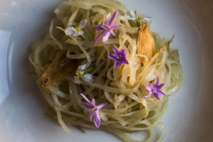 Par-cooked potato with society garlic flowers at Igni in Geelong.