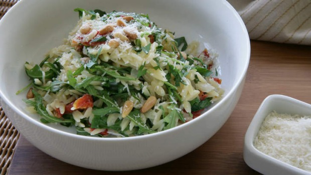 Orzo with rocket, semi-dried tomatoes and pine nuts Recipe | Good Food