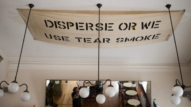 Amusing curios: An old police banner is pinned to the ceiling.