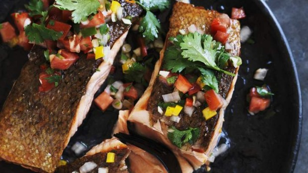 Crispy-skinned barbecue salmon with pebre.