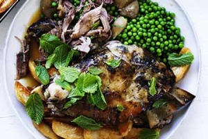 Slow-roasted lamb with tarragon, peas and crispy potatoes.