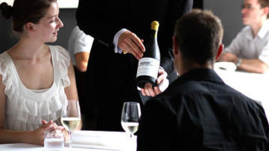 Sommelier and patrons at Marque restaurant.