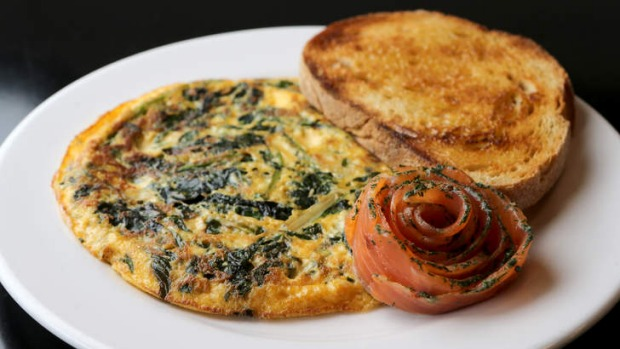 Collards omelette with smoked salmon rosette.