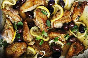 Braised chicken with lemon, oregano and olives.