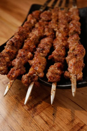 Sword-like lamb skewers.