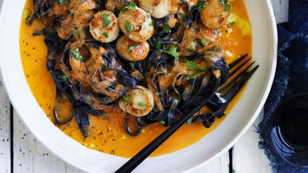 Squid ink pasta with scallops, chilli, tomato and garlic.