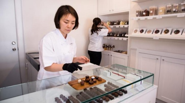 Jin Sun Kim, owner and head chocolatier, behind the counter of the new store.