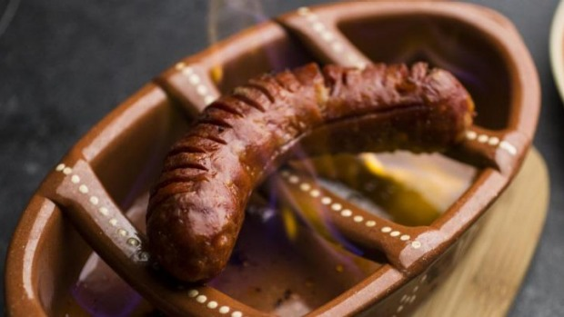 The flaming chorizo is soaked in sherry.