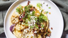 Spiced cauliflower and feta omelette with chorizo and almond dressing.