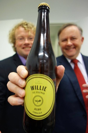 Anthony Albanese holding a bottle of the beer that was named after him.