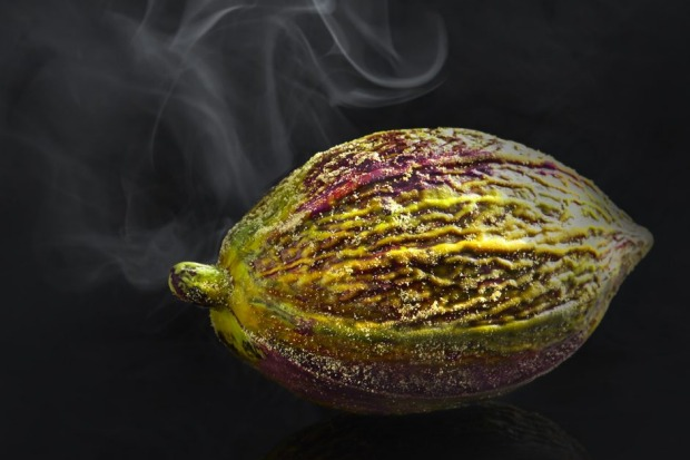 A cacao pod is smashed open to reveal petits fours at Lume.