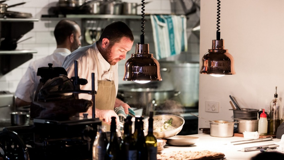 A chef plates up at Tipo 00 in Melbourne, not reopened - yet.