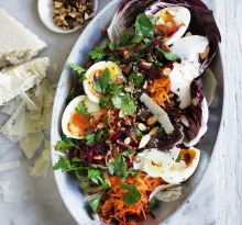 Soft-boiled eggs with beetroot, carrot and parsley salad.