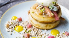 Pancakes with poached rhubarb, puffed grains, toasted hazelnuts and creme fraiche from St Ali in South Melbourne.