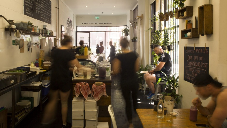 "Proteini Cafe in Darlinghurst is dotted with pot plants and daubed with a big ""Hello"" above its door."