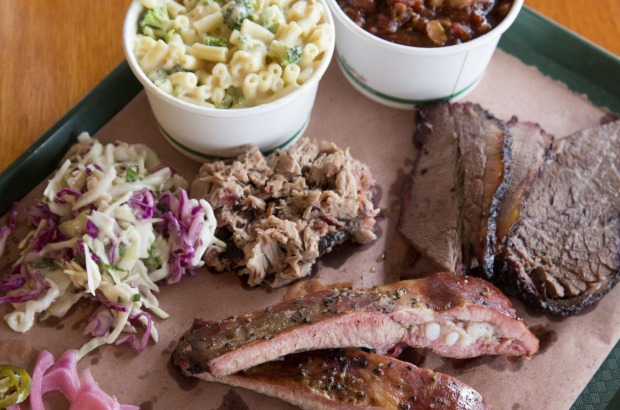 Barbecued meats, coleslaw, beans, mac 'n' cheese at Bovine & Swine.