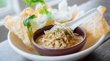 Chicken simmered in coconut cream with cassava crackers at E.P. & L.P.