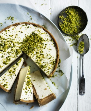 Adam Liaw's honey and cardamom cheesecake with crushed pistachios.