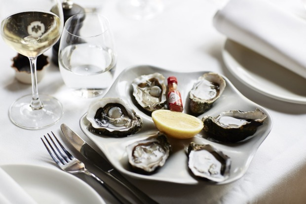 Fresh oysters served with a petit Tabasco bottle at the French Saloon.