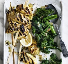 Adam Liaw's turmeric fish skewers and garlic greens.