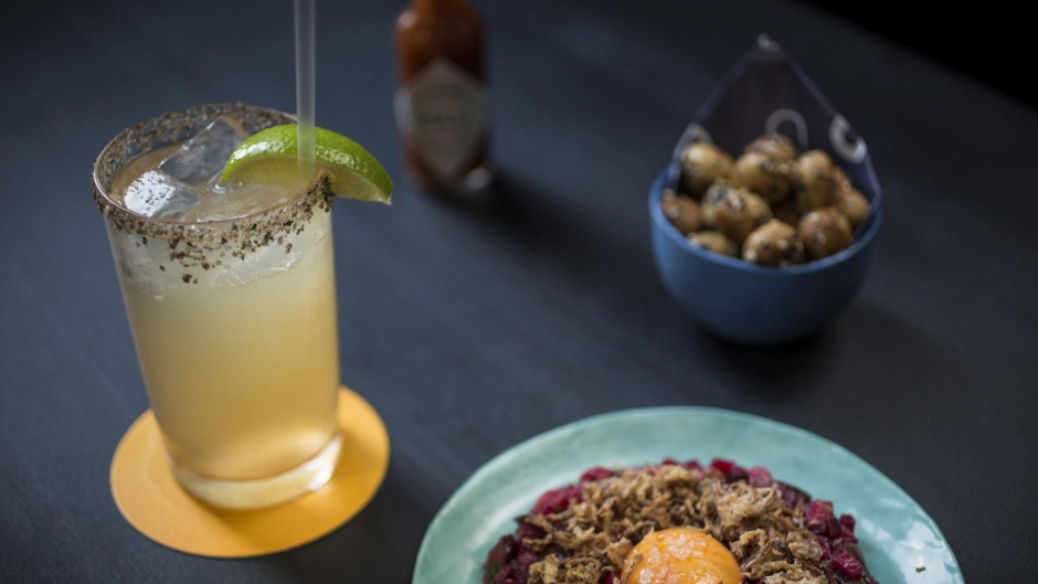 SYDNEY, AUSTRALIA - MAY 14:  Batanga cocktail with the pickled tartare and a bowl of macadamias served at PS Soda on May ...