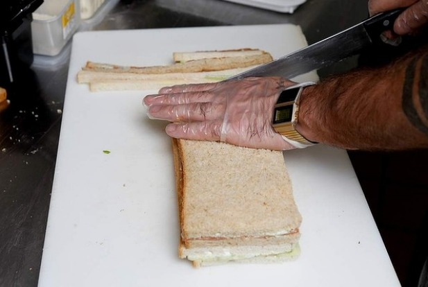 Step 12: Trim the four crusts using a serrated knife. 'Let the blade do the work for you,' Alderson says.
