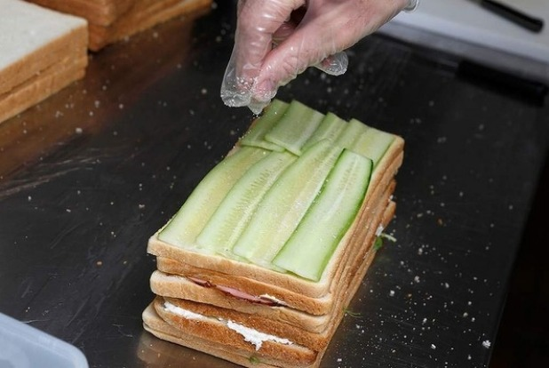 Step 10: Layer the alternating sandwich fillings in a stack. If using cucumber, be sure to pat it dry with paper towel ...