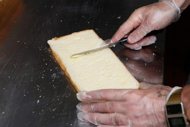 Step 8: Lightly (and gently) butter the bread slices using a metal spatula, being careful not to tear the bread.