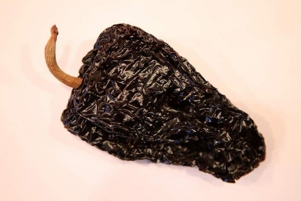 Large and heart-shaped, ancho chillies have a mild to hot, sweet fruit flavour reminiscent of raisin or prune.