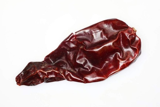 Guajillo chillies are bright red, conical and up to 14 centimetres long. They can be very hot, with fruity berry overtones.