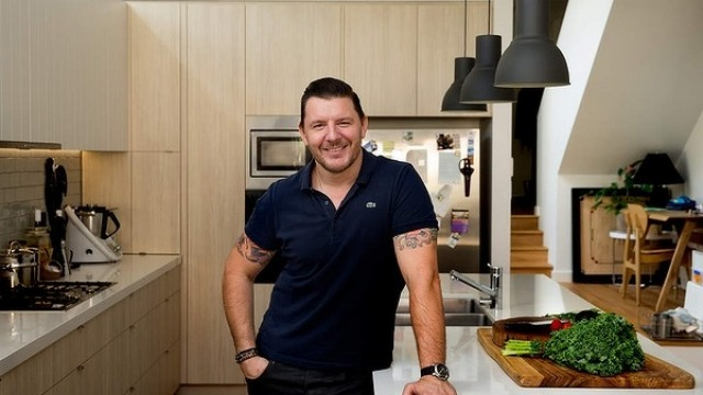 Manu Feildel inside his home kitchen.