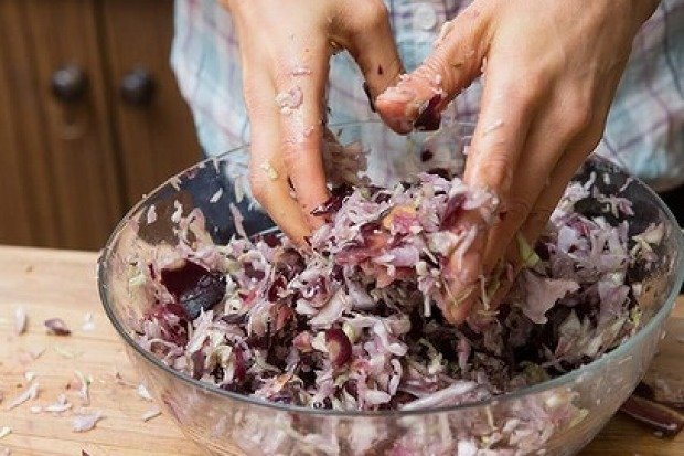 Toss the vegetables, salt, herbs and spices together thoroughly using your hands.