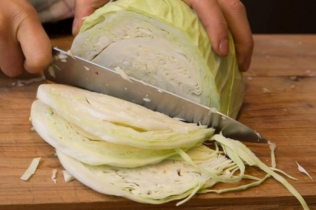 After you have removed the outer tough and dirty leaves of the cabbage, cut it into quarters, remove the core then slice ...