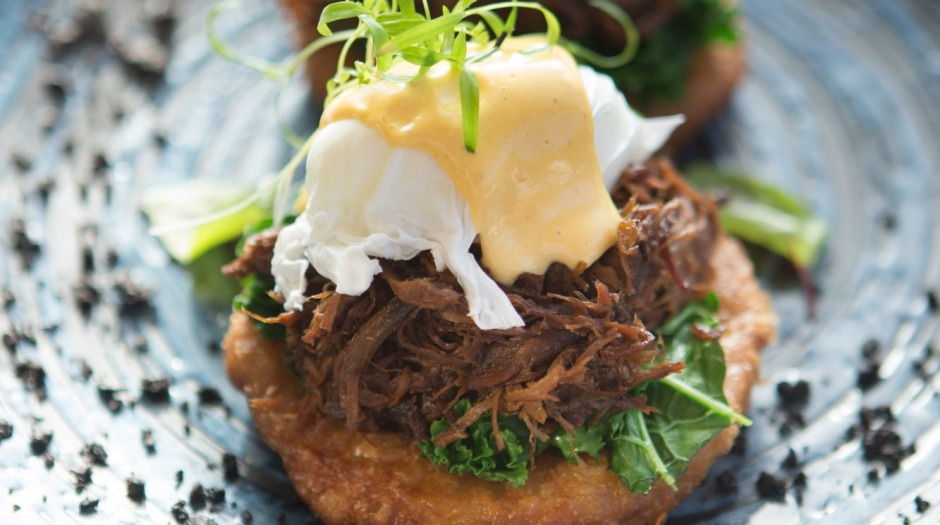 Bluestone Benedict: Roti piled with braised beef cheek, kale, poached egg and hollandaise.